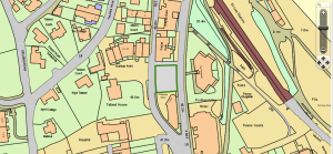 The six-flat construction project is outlines in green on this map, which is part of application PA15/04337. Talland House is located behind it to the left and is labeled as such.