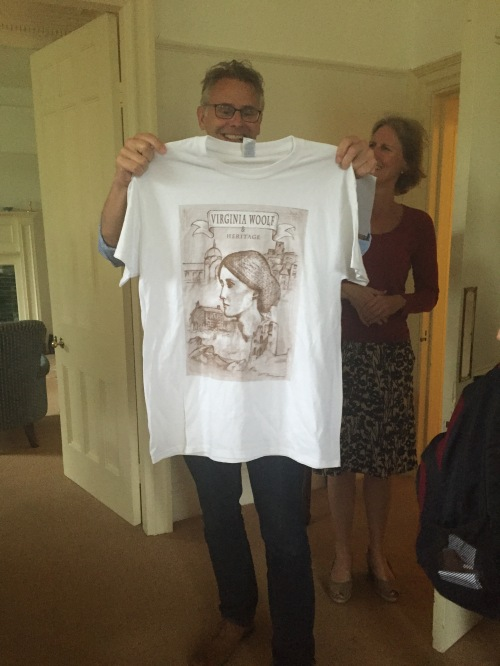 The headmaster of Giggleswick School accepts a conference T-shirt as a gift of thanks for allowing us into his home.